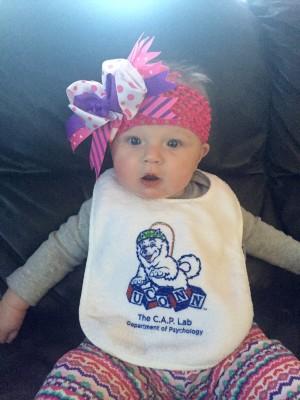 Baby wearing CAP lab bib